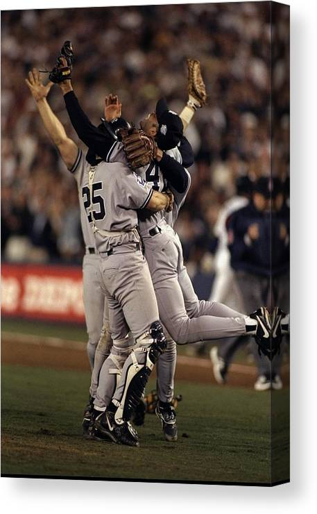 Following Canvas Print featuring the photograph Mariano Rivera and Joe Girardi by Al Bello