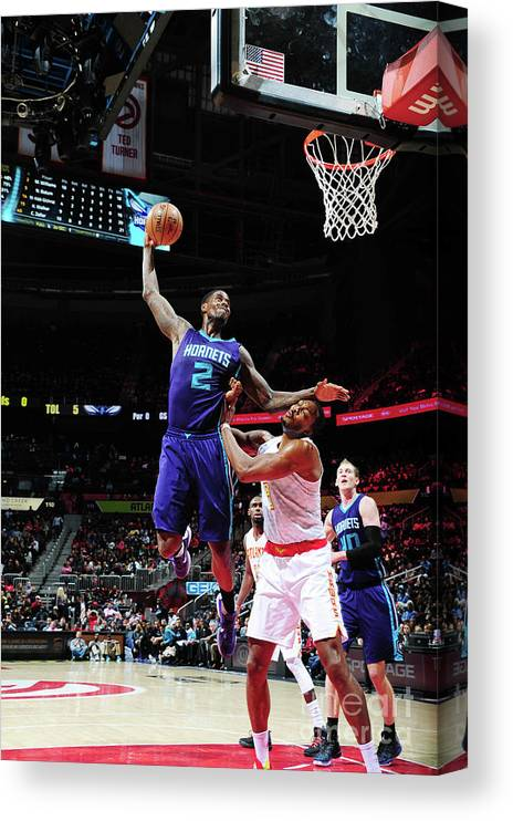 Atlanta Canvas Print featuring the photograph Marvin Williams and Dwight Howard by Scott Cunningham
