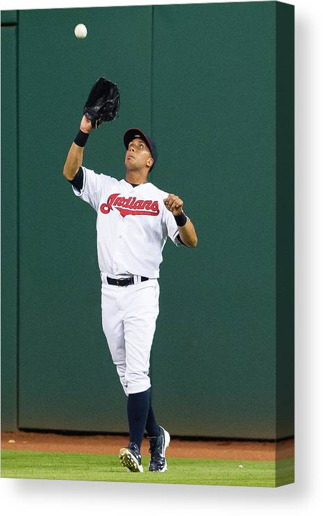 People Canvas Print featuring the photograph Michael Brantley and Carlos Correa by Jason Miller