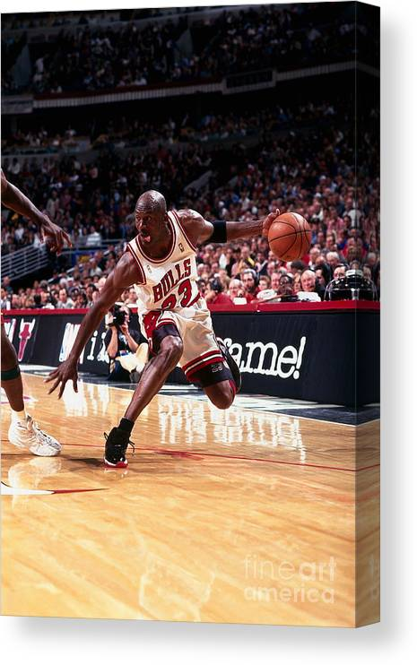 Chicago Bulls Canvas Print featuring the photograph Michael Jordan by Barry Gossage