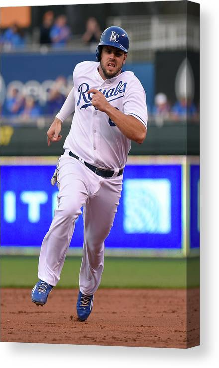 People Canvas Print featuring the photograph Mike Moustakas and Lorenzo Cain by Ed Zurga