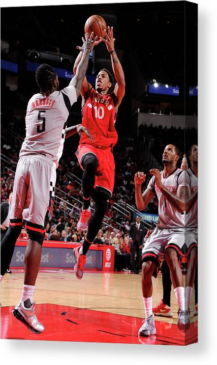Nba Pro Basketball Canvas Print featuring the photograph Montrezl Harrell and Demar Derozan by Bill Baptist