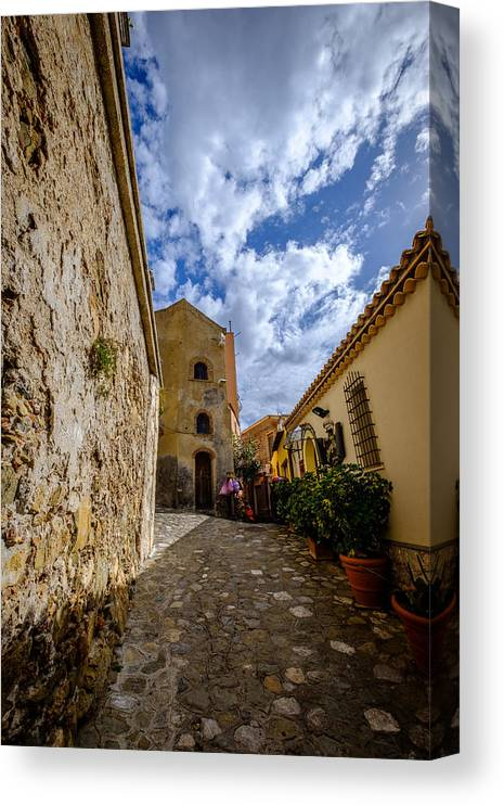 Sicily Canvas Print featuring the photograph Narrow alley and old houses with plants outside in Castelmola Taormina Sicily Italy by Finn Bjurvoll Hansen