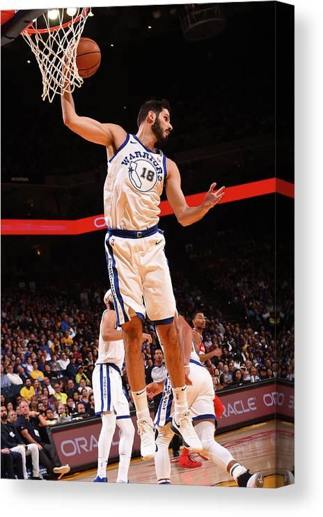 Nba Pro Basketball Canvas Print featuring the photograph Omri Casspi by Noah Graham