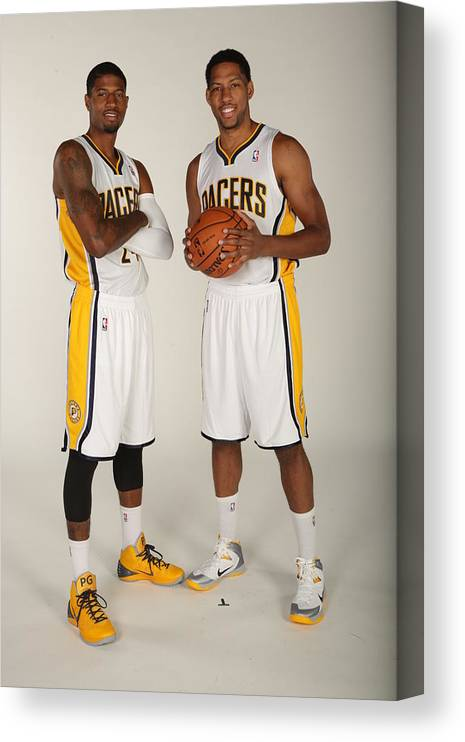 Media Day Canvas Print featuring the photograph Paul George and Danny Granger by Ron Hoskins