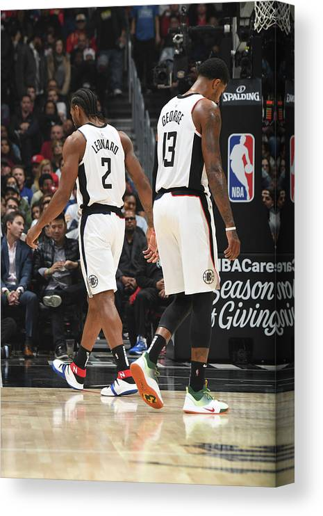 Nba Pro Basketball Canvas Print featuring the photograph Paul George and Kawhi Leonard by Andrew D. Bernstein