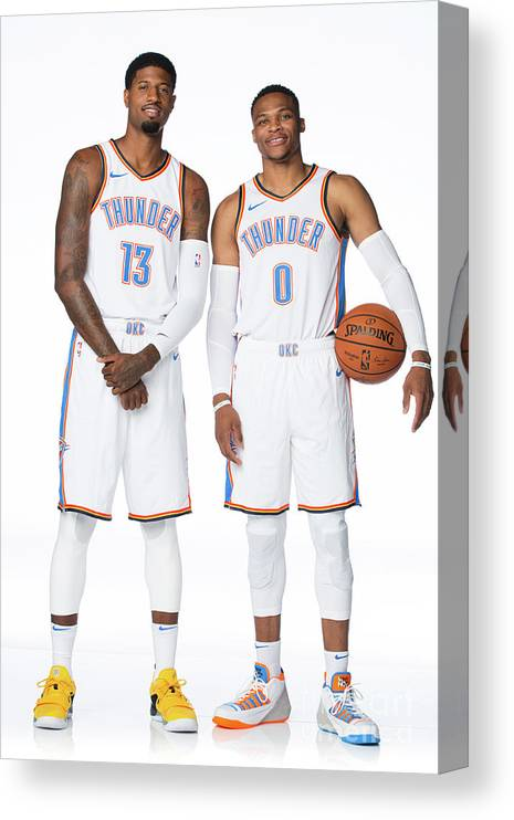 Media Day Canvas Print featuring the photograph Paul George and Russell Westbrook by Nba Photos