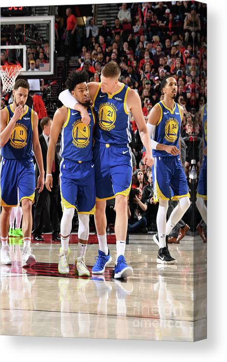 Nba Pro Basketball Canvas Print featuring the photograph Quinn Cook and Jonas Jerebko by Andrew D. Bernstein