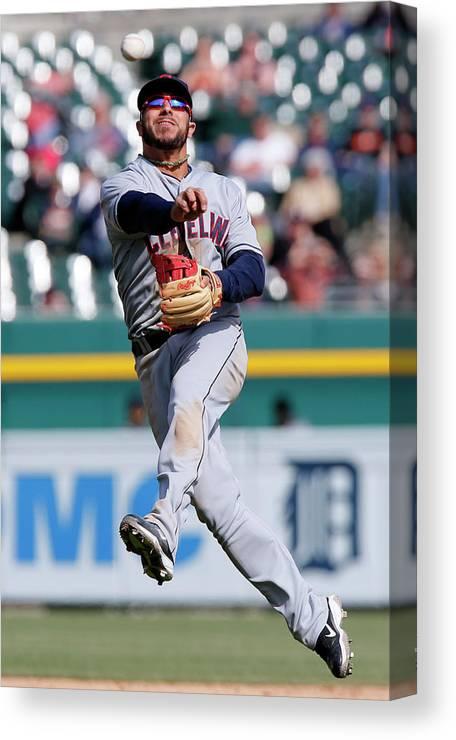 American League Baseball Canvas Print featuring the photograph Rajai Davis and Mike Aviles by Duane Burleson