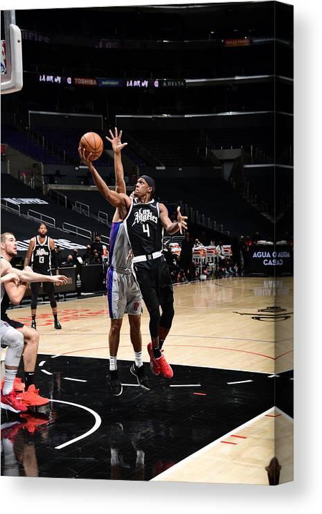 Nba Pro Basketball Canvas Print featuring the photograph Rajon Rondo by Adam Pantozzi