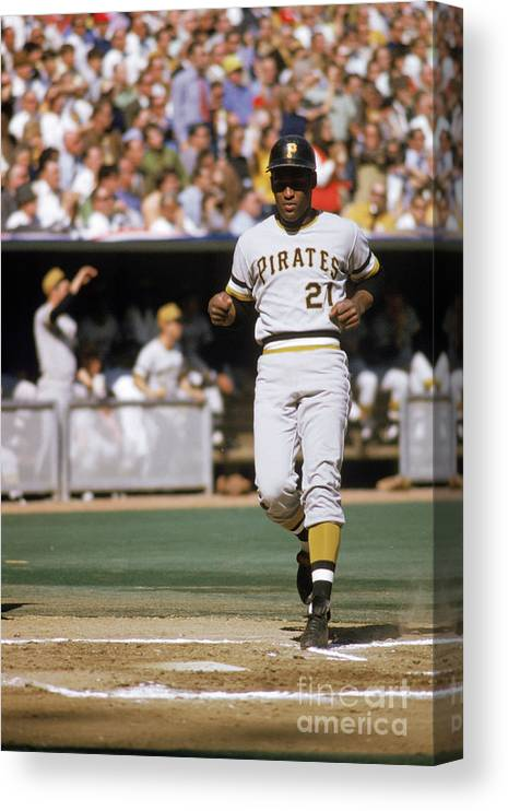 Scoring Canvas Print featuring the photograph Roberto Clemente by Mlb Photos