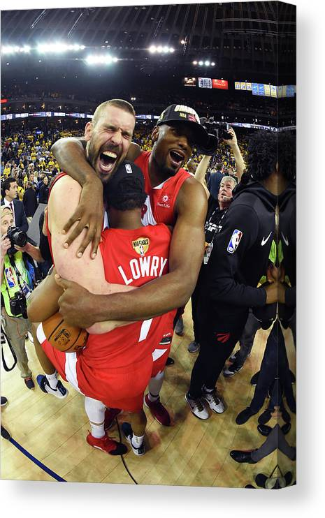 Playoffs Canvas Print featuring the photograph Serge Ibaka, Marc Gasol, and Kyle Lowry by Andrew D. Bernstein