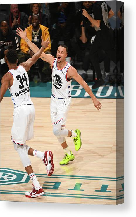 Nba Pro Basketball Canvas Print featuring the photograph Stephen Curry and Giannis Antetokounmpo by Garrett Ellwood