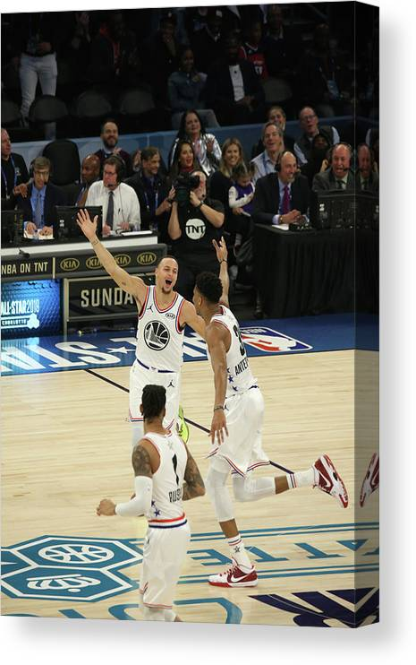 Following Canvas Print featuring the photograph Stephen Curry and Giannis Antetokounmpo by Gary Dineen