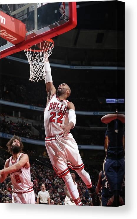 Nba Pro Basketball Canvas Print featuring the photograph Taj Gibson by Gary Dineen