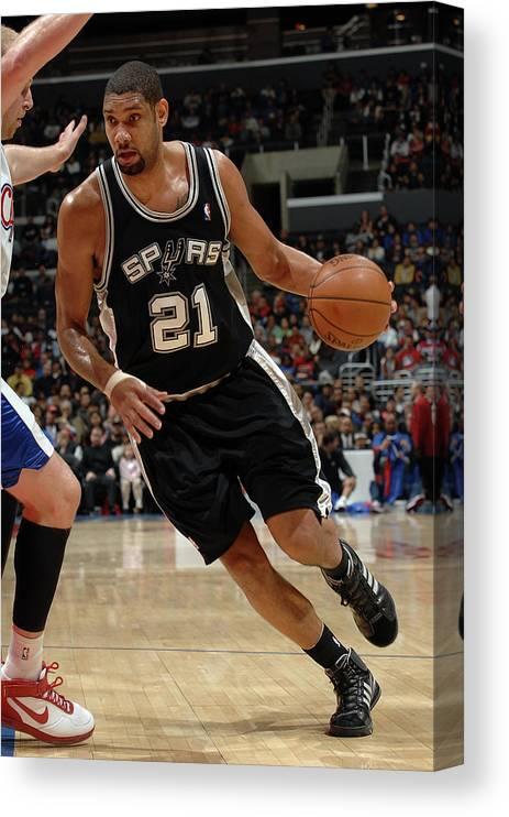 Nba Pro Basketball Canvas Print featuring the photograph Tim Duncan and Chris Kaman by Noah Graham