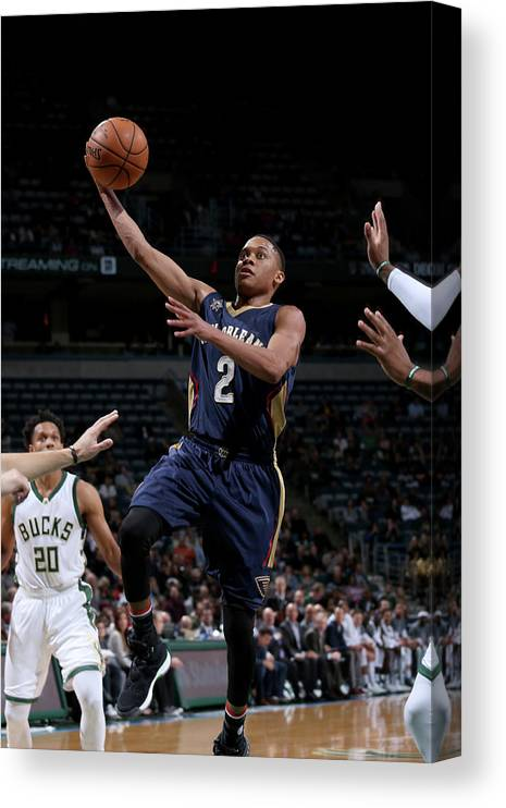 Nba Pro Basketball Canvas Print featuring the photograph Tim Frazier by Gary Dineen