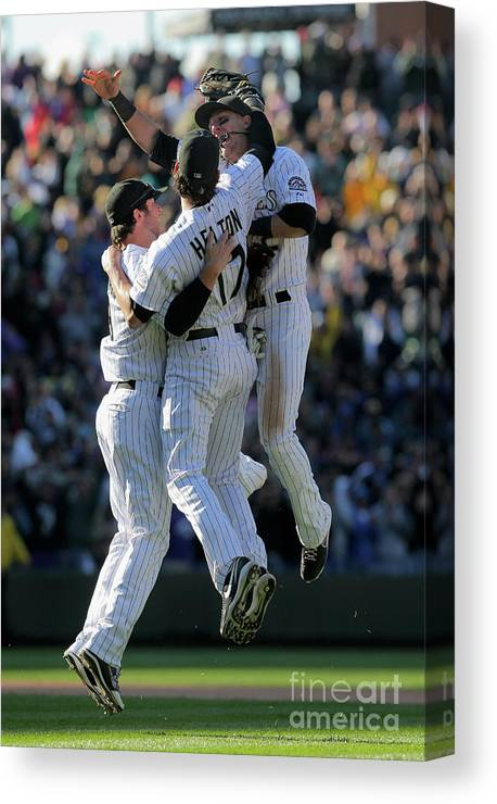 Celebration Canvas Print featuring the photograph Todd Helton, Ian Stewart, and Troy Tulowitzki by Doug Pensinger