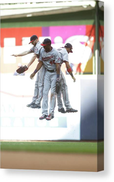 People Canvas Print featuring the photograph Torii Hunter and Eduardo Escobar by Mike Mcginnis