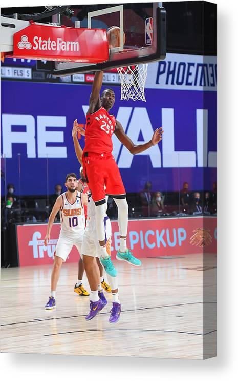 Nba Pro Basketball Canvas Print featuring the photograph Toronto Raptors v Phoenix Suns by Bill Baptist