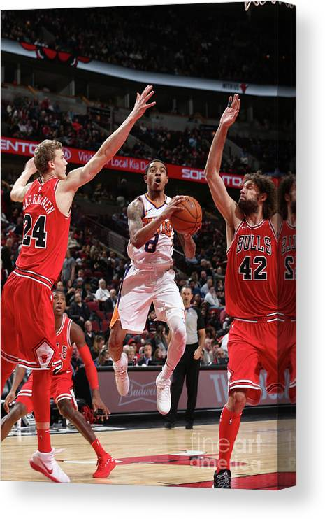 Chicago Bulls Canvas Print featuring the photograph Tyler Ulis, Lauri Markkanen, and Robin Lopez by Gary Dineen