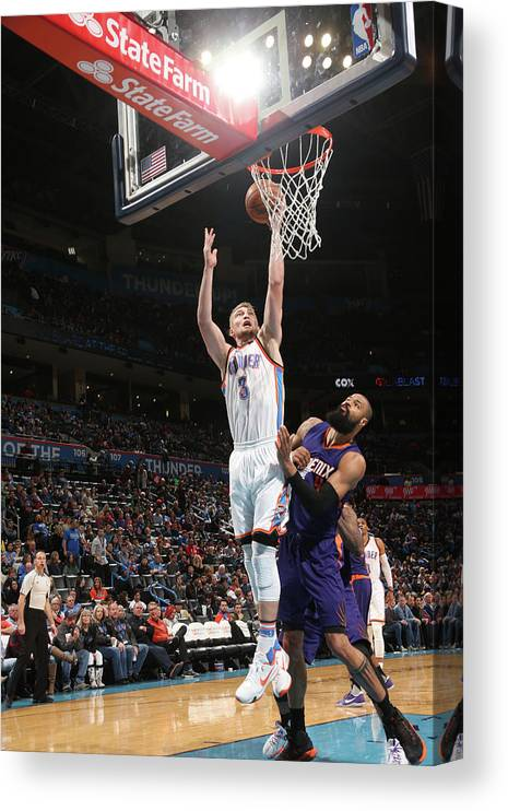 Nba Pro Basketball Canvas Print featuring the photograph Tyson Chandler and Domantas Sabonis by Layne Murdoch