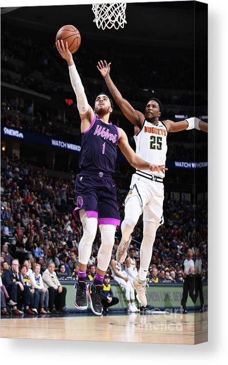 Nba Pro Basketball Canvas Print featuring the photograph Tyus Jones by Garrett Ellwood