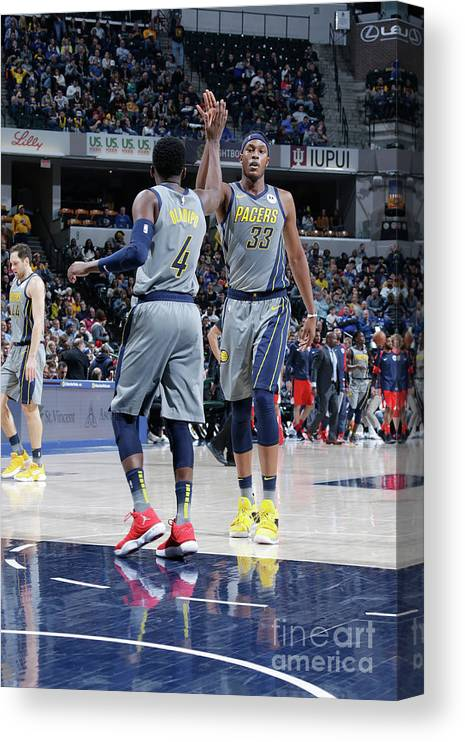 Nba Pro Basketball Canvas Print featuring the photograph Victor Oladipo and Myles Turner by Ron Hoskins