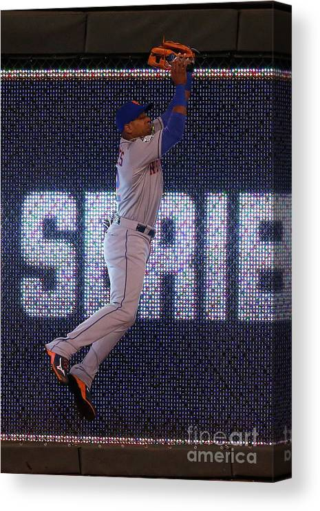 Game Two Canvas Print featuring the photograph Yoenis Cespedes and Alex Rios by Christian Petersen
