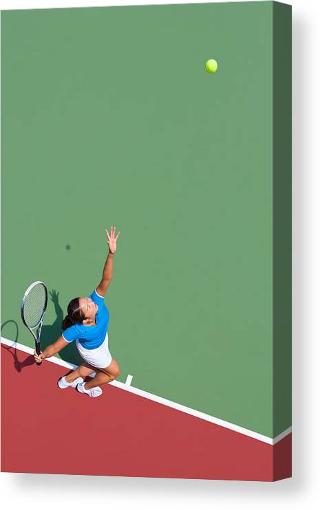 Asian And Indian Ethnicities Canvas Print featuring the photograph Young tennis player serving by Nycshooter