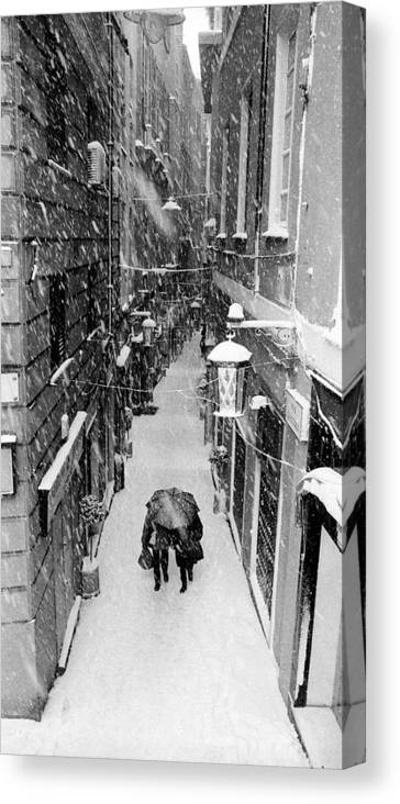 Street Canvas Print featuring the photograph Snowfall In Genoa by Andrea Gabrieli