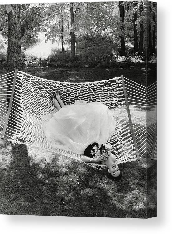 Landscape Canvas Print featuring the photograph A Model Lying On A Hammock by Gene Moore
