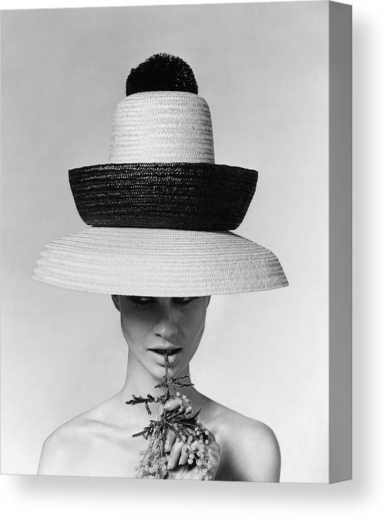 Accessories Canvas Print featuring the photograph A Model Wearing A Sun Hat by Karen Radkai