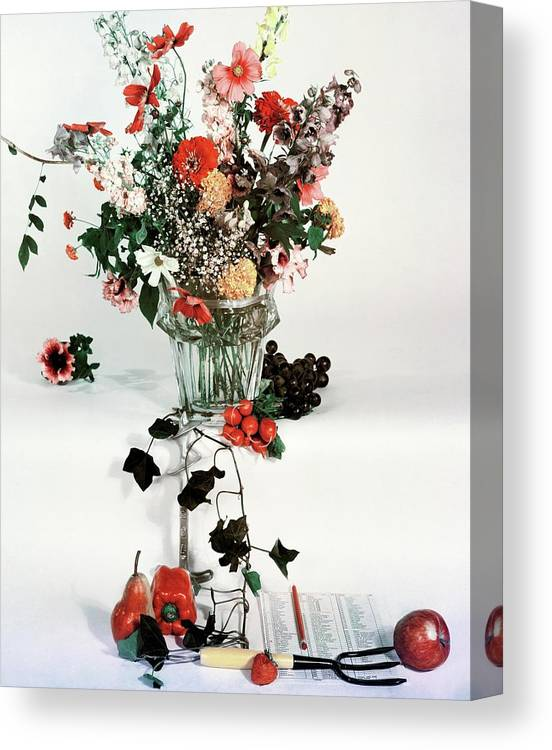 Nobody Canvas Print featuring the photograph A Studio Shot Of A Vase Of Flowers And A Garden by Herbert Matter