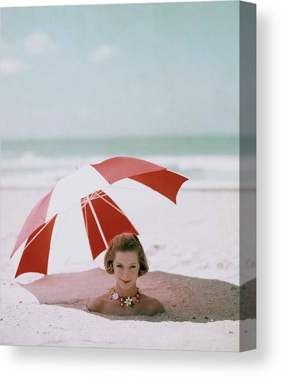Beauty Canvas Print featuring the photograph A Woman Buried In Sand At A Beach by Richard Rutledge