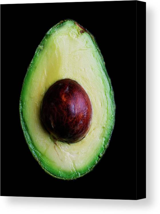 Fruits Canvas Print featuring the photograph An Avocado by Romulo Yanes