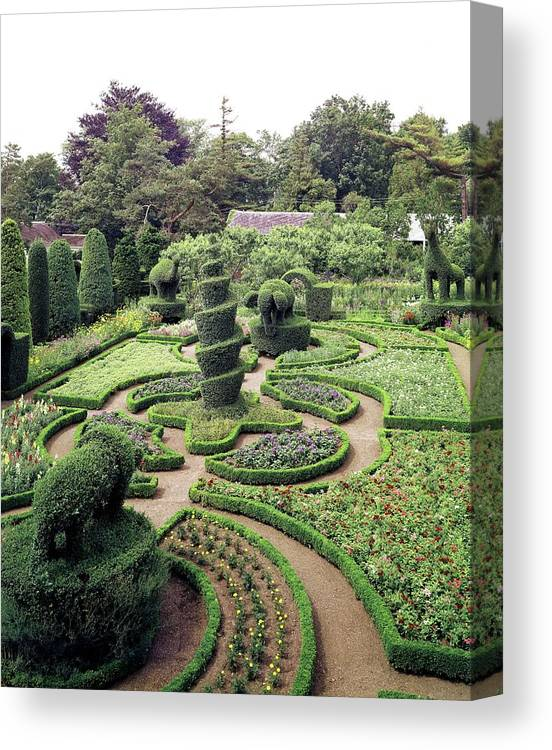 Exterior Canvas Print featuring the photograph An Ornamental Garden by Tom Leonard