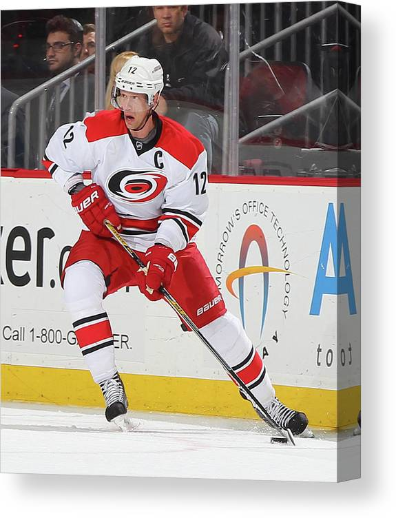 People Canvas Print featuring the photograph Carolina Hurricanes V New Jersey Devils by Andy Marlin