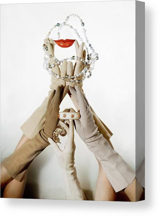 Accessories Canvas Print featuring the photograph Gloved Hands Holding Jewelry by John Rawlings