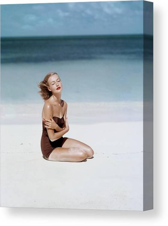 Fashion Canvas Print featuring the photograph Liz Benn Sitting On A Beach by John Rawlings