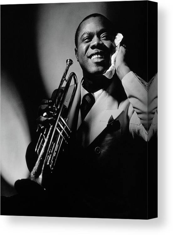 Portrait Canvas Print featuring the photograph Louis Armstrong Holding A Trumpet by Anton Bruehl