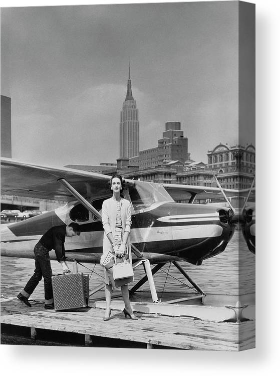 Two People Canvas Print featuring the photograph Lucille Cahart With Small Plane in NYC by John Rawlings