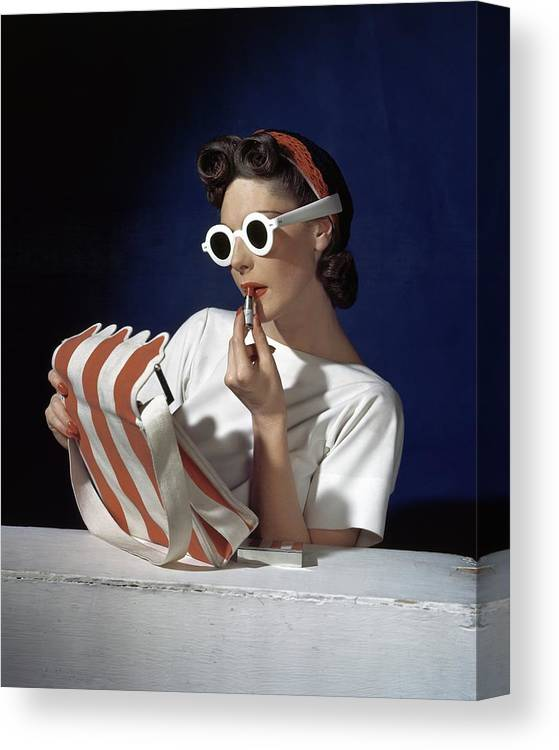 Accessories Canvas Print featuring the photograph Muriel Maxel Applying Lipstick by Horst P. Horst