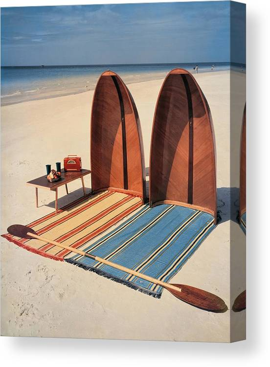 Accessories Canvas Print featuring the photograph Pixie Collapsible Boat On The Beach by Lois and Joe Steinmetz