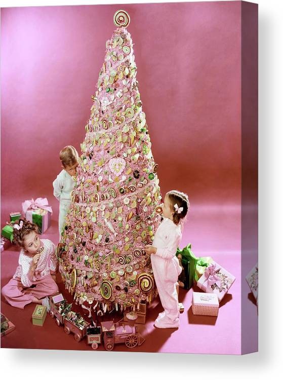 Three People Canvas Print featuring the photograph Three Children Eating A Candy Christmas Tree by Herbert Matter