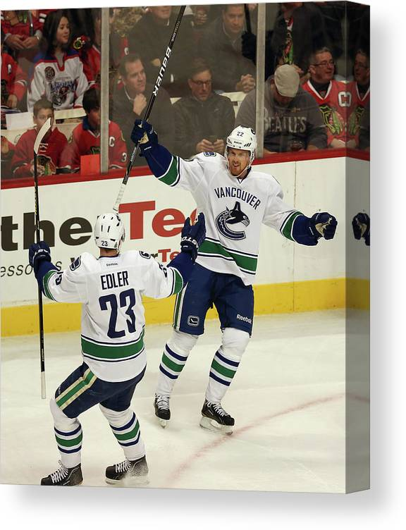 United Center Canvas Print featuring the photograph Vancouver Canucks V Chicago Blackhawks by Jonathan Daniel