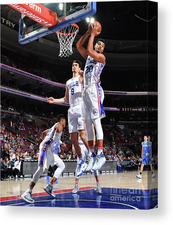 Nba Pro Basketball Canvas Print featuring the photograph Philadelphia 76ers V Orlando Magic by Jesse D. Garrabrant
