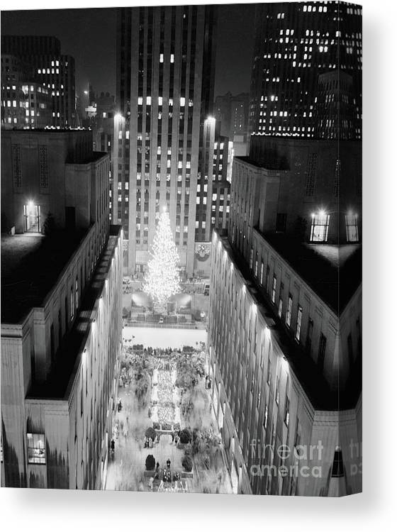 Christmas Tree Lighting Ceremony Canvas Print featuring the photograph Aerial View Of Rockefeller Center by Bettmann