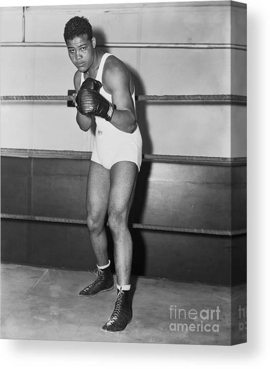 Young Men Canvas Print featuring the photograph Boxing Champion Joe Louis by Bettmann