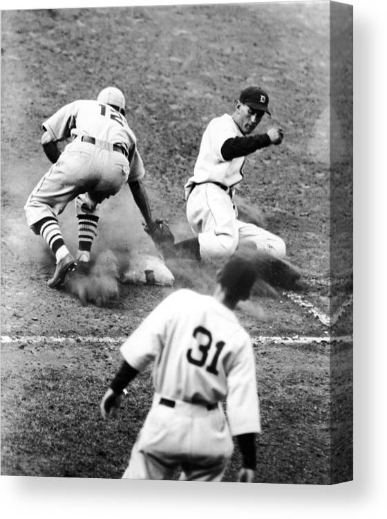 St. Louis Cardinals Canvas Print featuring the photograph Charlie Gehringer Slides Into First Base by Fpg